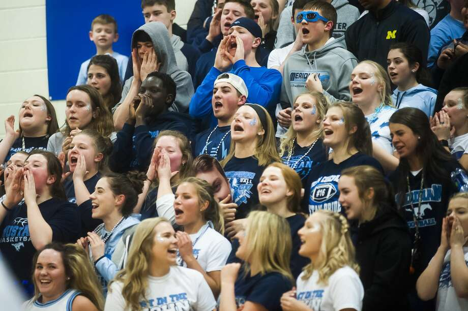 Meridian fans in the student section celebrate a point during the Mustangs' regionals victory over Mason County Central on Wednesday, March 14, 2018 at Beal City High School. (Katy Kildee/kkildee@mdn.net) Photo: (Katy Kildee/kkildee@mdn.net)