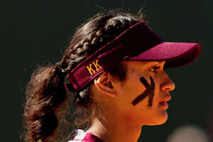 Deer Park third baseman KK Morado (18) is seen during the first inning of a non-district high school softball game at The Woodlands High School, Wednesday, March 14, 2018, in The Woodlands. Deer Park defeated The Woodlands 4-2.