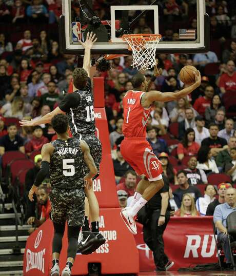 HOUSTON, TX - MARCH 12:  Trevor Ariza #1 of the Houston Rockets drives past Pau Gasol #16 of the San Antonio Spurs for a layup as Dejounte Murray #5 looks on at Toyota Center on March 12, 2018 in Houston, Texas. NOTE TO USER: User expressly acknowledges and agrees that, by downloading and or using this photograph, User is consenting to the terms and conditions of the Getty Images License Agreement.  (Photo by Bob Levey/Getty Images) Photo: Bob Levey, Stringer / 2018 Getty Images