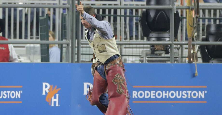 Bill Tutor reacts to his score in the bareback riding competition during the 2018 Rodeo Houston Semifinal 1 at NRG Stadium on Wednesday, March 14, 2018, in Houston. ( Elizabeth Conley / Houston Chronicle ) Photo: Elizabeth Conley/Houston Chronicle