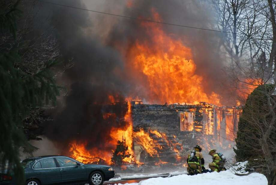 A yellow ranch house at 151 Adams Place in Delmar was destroyedy by fire on Saturday, Dec. 19. Neighbors say they heard an explosion before the fire broke out. (Tom Heffernan Sr./Special to the Times Union)