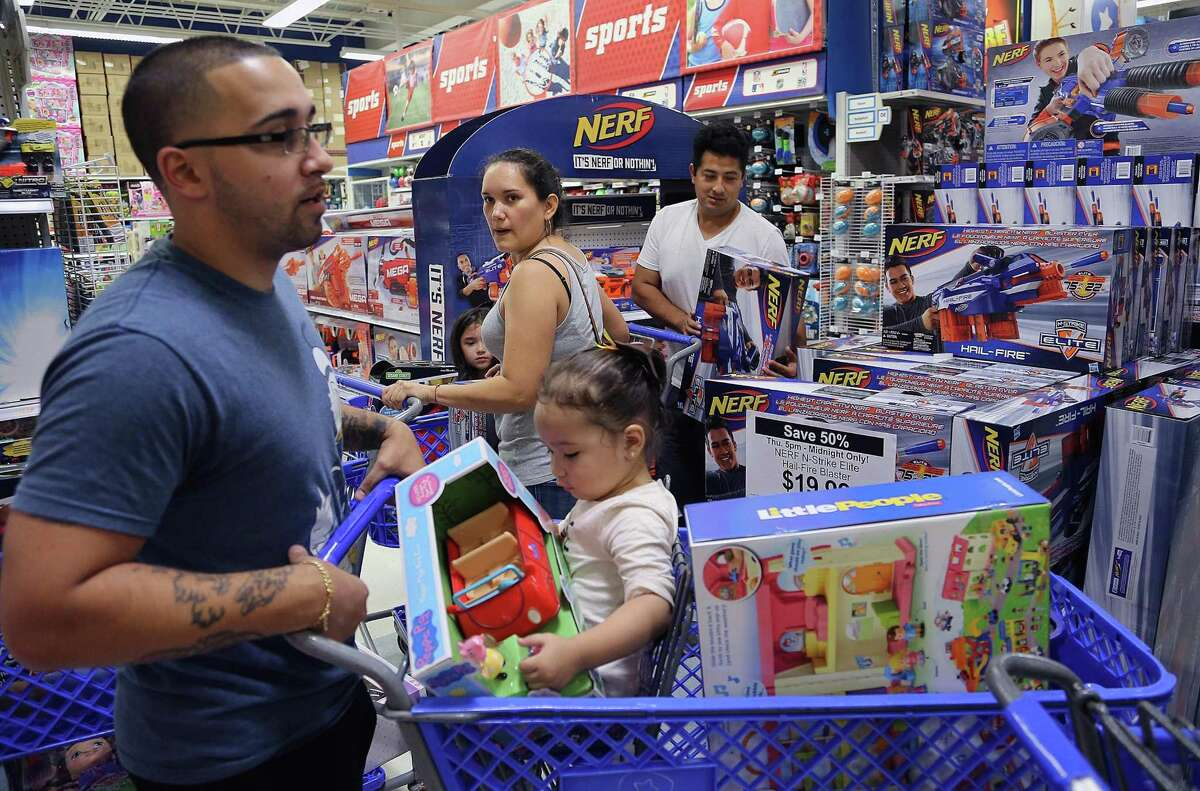 Shoppers scramble for Black Friday deals at a Toys R Us in November in Doral, Fla.