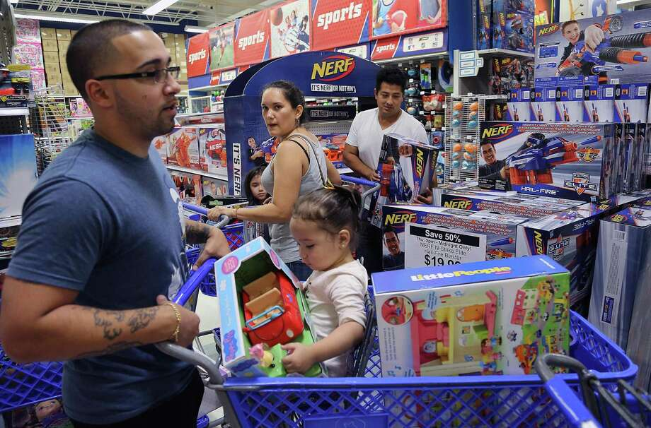 Shoppers scramble for Black Friday deals at a Toys R Us in November in Doral, Fla. Photo: Carl Juste / Carl Juste / Miami Herald / Miami Herald