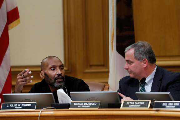 San Francisco Police Commission President Julius Turman tries to dissuade Vice President Thomas Mazzucco from asking SFPD Chief Bill Scott to clarify a point in  a proposed Taser use policy during a police commission meeting at City Hall in San Francisco, Calif., on Wednesday, March 14, 2018. The long debate over whether San Francisco police officers should carry Tasers has ended, only to be replaced by a similarly contentious dispute over how the city should regulate use of the electroshock weapons. The Police Commission discussed a Taser policy drafted by the Police Department after it convened several community working groups.