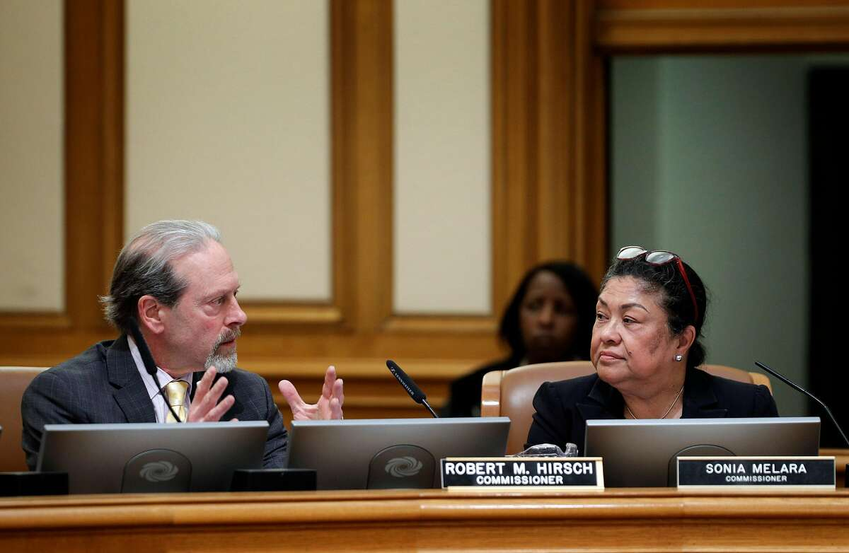 San Francisco Police Commissioner Robert Hirsch talks with Commisisoner Sonia Melara at his right, bringing up specific, questionable wording in a proposed Taser use policy during a police commission meeting at City Hall in San Francisco, Calif., on Wednesday, March 14, 2018. The long debate over whether San Francisco police officers should carry Tasers has ended, only to be replaced by a similarly contentious dispute over how the city should regulate use of the electroshock weapons. The Police Commission discussed a Taser policy drafted by the Police Department after it convened several community working groups.