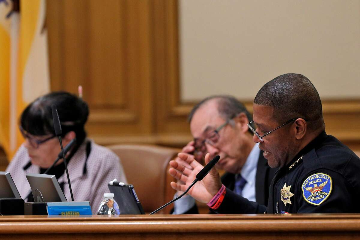 San Francisco Police Chief Bill Scott reads from a proposed Taser use policy during a police commission meeting at City Hall in San Francisco, Calif., on Wednesday, March 14, 2018. The long debate over whether San Francisco police officers should carry Tasers has ended, only to be replaced by a similarly contentious dispute over how the city should regulate use of the electroshock weapons. The Police Commission discussed a Taser policy drafted by the Police Department after it convened several community working groups.