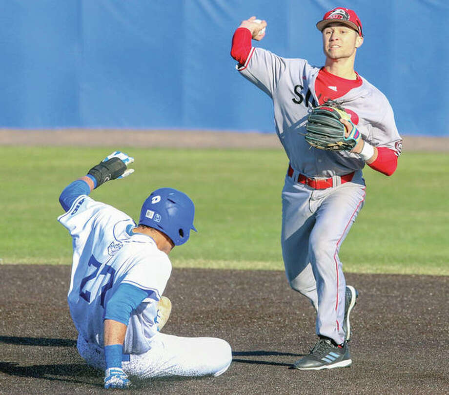 SIUE second baseman Jordan Ross, right, throws to first base after forcing out Saint Louis University's Tm Bushnell during Wednesday's game at the Billiken Sports Complex. Photo: SIUE Athletics