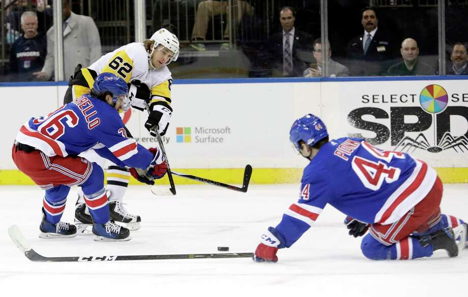 New York Rangers' Mats Zuccarello (36) and Neal Pionk (44) defend a shot by Pittsburgh Penguins' Carl Hagelin (62) during the first period of an NHL hockey game Wednesday, March 14, 2018, in New York. (AP Photo/Frank Franklin II) Photo: Frank Franklin II / Copyright 2018 The Associated Press. All rights reserved.
