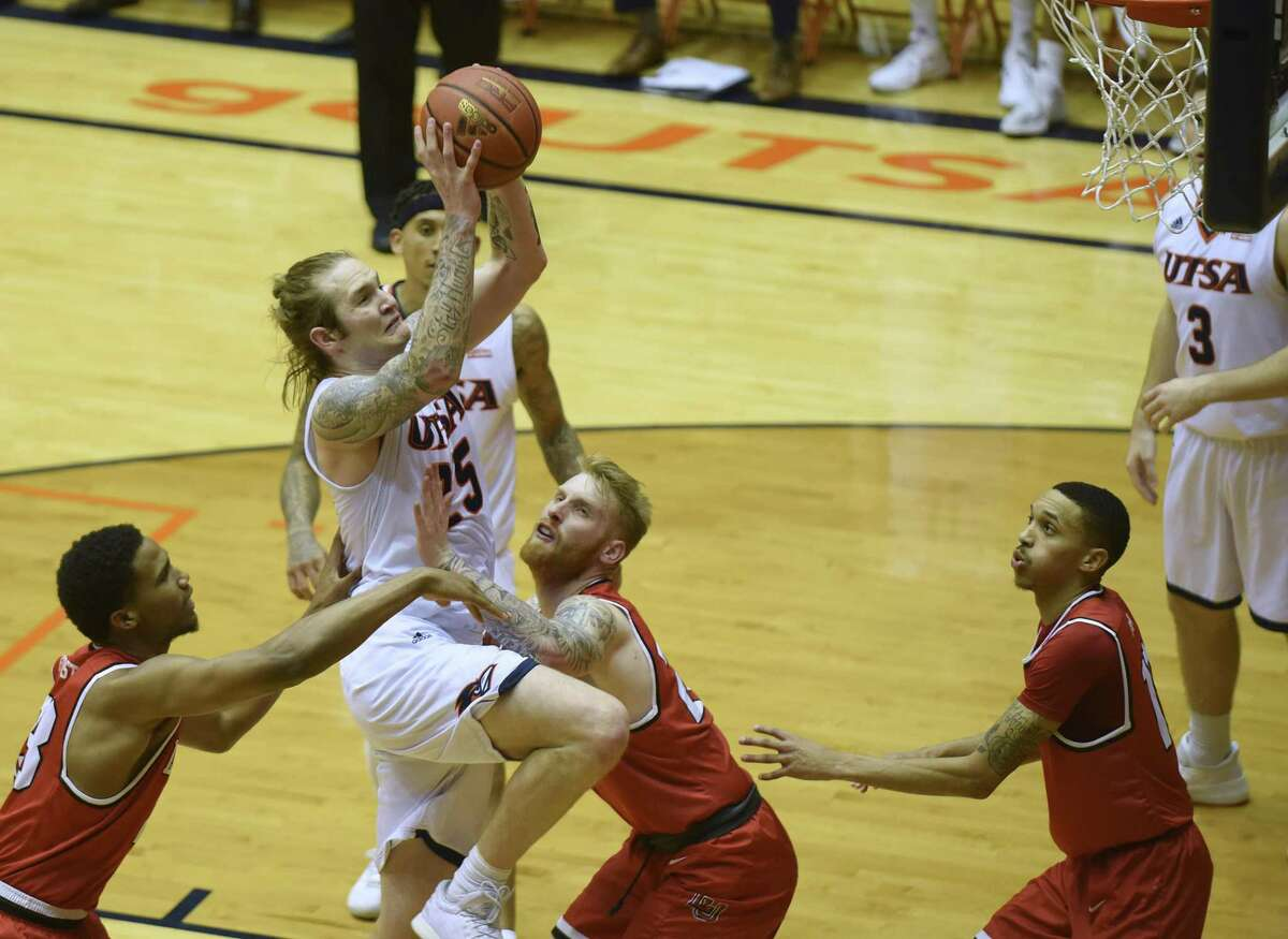 UTSA's Nick Allen is fouled by Lamar's Jordan Foster, left, and Colton Weisbrod during second-half CollegeInsider.com tournament action in the UTSA Convocation Center on Wednesday, March 14, 2018. UTSA won the game, 76-69.