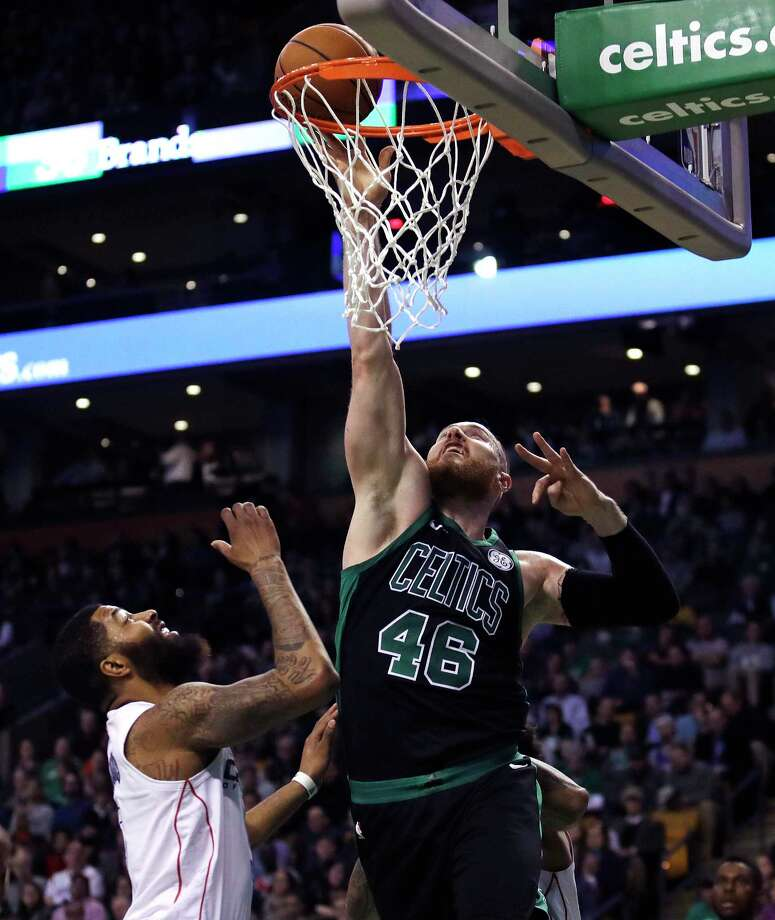 Boston Celtics center Aron Baynes (46) tips in a rebound over Washington Wizards forward Markieff Morris during the first quarter of an NBA basketball game in Boston, Wednesday, March 14, 2018. (AP Photo/Charles Krupa) Photo: Charles Krupa / Copyright 2018 The Associated Press. All rights reserved.