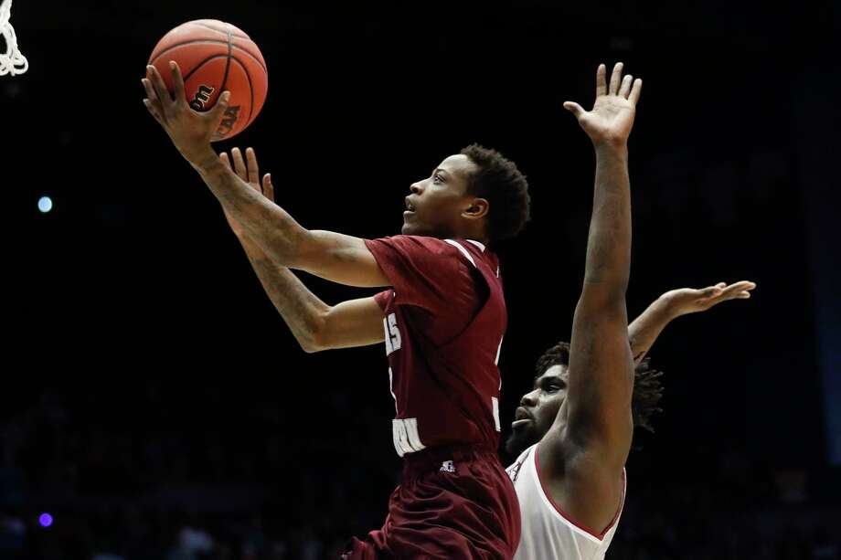 Texas Southern's Demontrae Jefferson shoots in front of North Carolina Central's Larry McKnight Jr., right, during the first half of a First Four game of the NCAA men's college basketball tournament Wednesday, March 14, 2018, in Dayton, Ohio. (AP Photo/John Minchillo) Photo: John Minchillo / AP