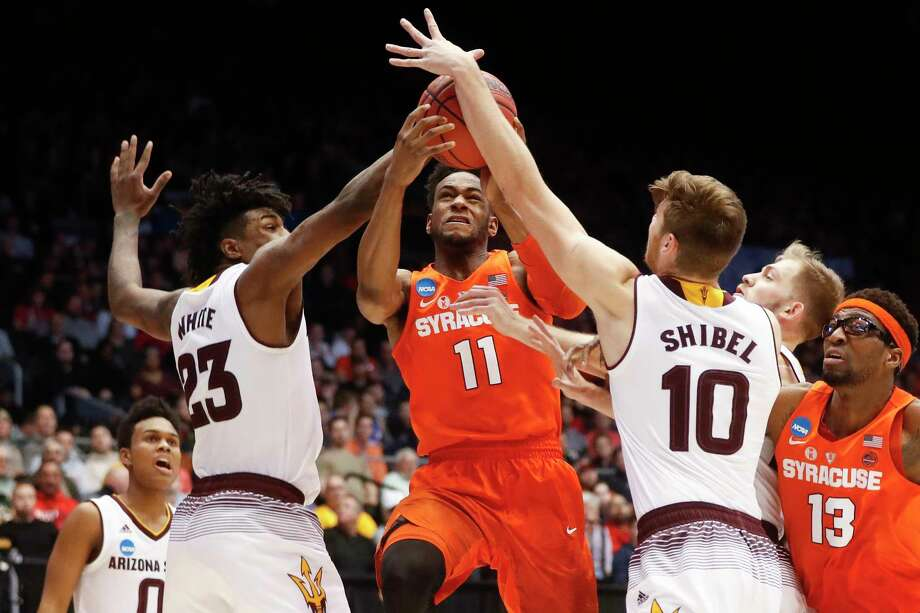 Syracuse's Oshae Brissett (11) drives against Arizona State's Romello White (23) and Vitaliy Shibel (10) during the second half of a First Four game of the NCAA men's college basketball tournament Wednesday, March 14, 2018, in Dayton, Ohio. Syracuse won 60-56. (AP Photo/John Minchillo) Photo: John Minchillo / AP