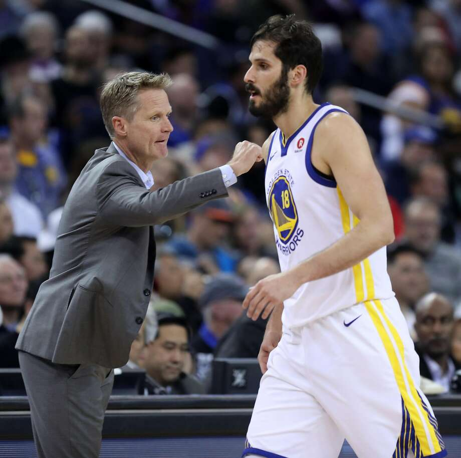 Golden State Warriors' head coach Steve Kerr welcomes Omir Casspi back to the bench in 2n quarter against Los Angeles Lakers during NBA game at Oracle Arena in Oakland, Calif., on Wednesday, March 14, 2018. Photo: Scott Strazzante, The Chronicle