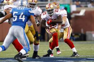 San Francisco 49ers running back Frank Gore (21) runs the ball in the second half of an NFL football game against the Detroit Lions in Detroit, Sunday, Oct. 16, 2011. (AP Photo/Rick Osentoski)