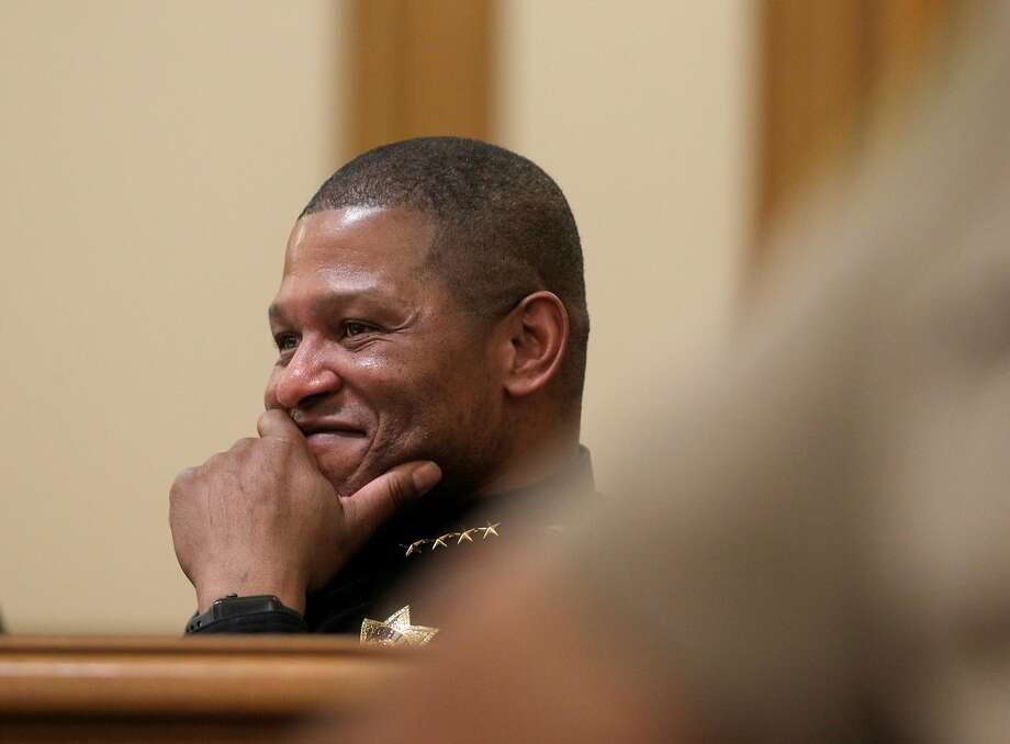 San Francisco Police Chief Bill Scott smiles at a joke from a public commenter during a police commission meeting at City Hall in San Francisco, on Wednesday, March 14.The San Francisco Police Commission voted to adopt a policy regulating how officers can use Tasers. Photo: Carlos Avila Gonzalez, The Chronicle