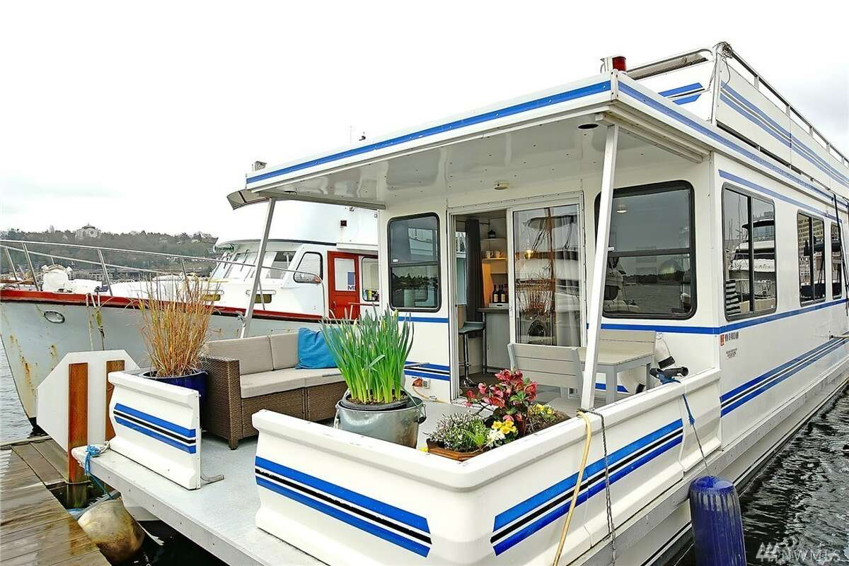 Lake Union floating home with its own roof deck and slide, yours for $225K.