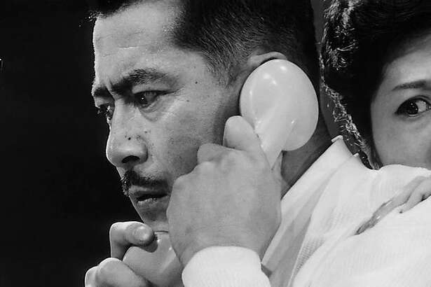 "Toshiro Mifune (left) Kyoko Kagawa in Akira Kurosawa's ""High and Low"" (1963)."