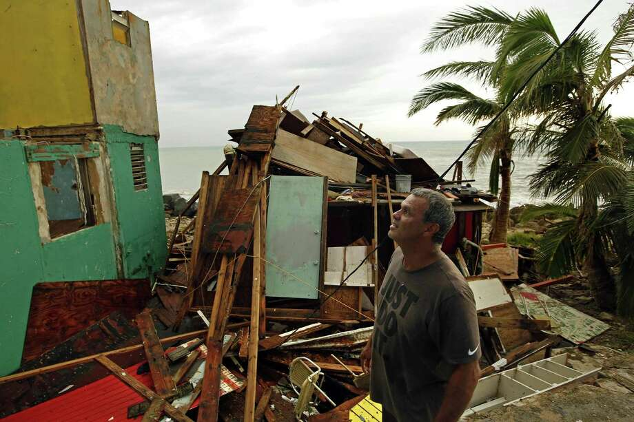 A resident of San Juan, Puerto Rico surveys damage on the heels of Hurricane Maria in September 2017. (Carolyn Cole/Los Angeles Times/TNS) Photo: Carolyn Cole / TNS / Los Angeles Times