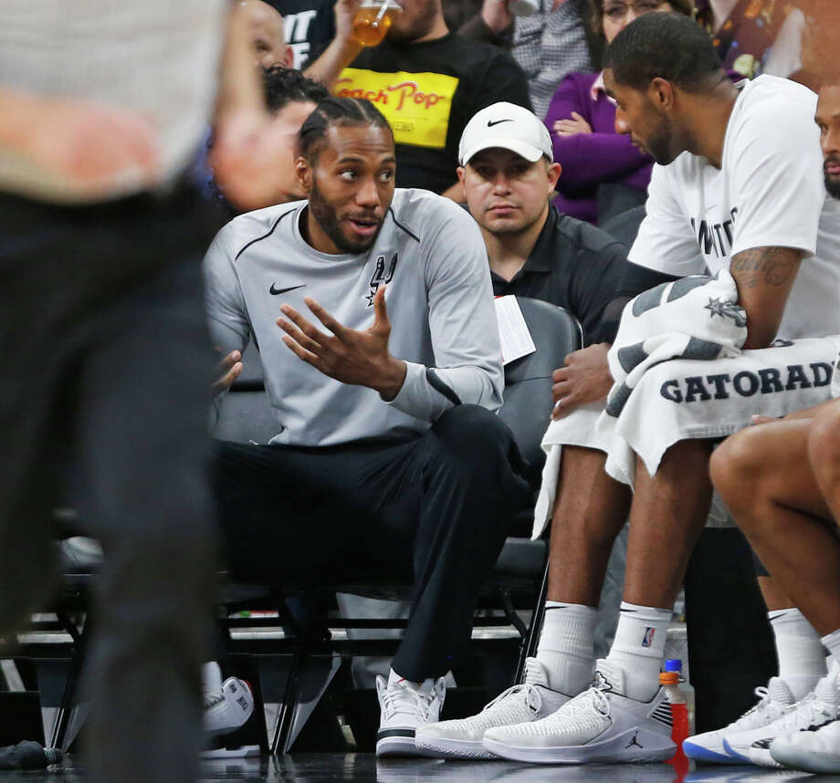FILE PHOTO:  Kawhi Leonard #2 of the San Antonio Spurs still not playing talks with teammate LaMarcus Aldridge #12 of the San Antonio Spurs during game against the Orlando Magic at AT&T Center on March 13, 2018  in San Antonio, Texas.  NOTE TO USER: User expressly acknowledges and agrees that , by downloading and or using this photograph, User is consenting to the terms and conditions of the Getty Images License Agreement. (Photo by Ronald Cortes/Getty Images) Photo: Ronald Cortes/Getty Images