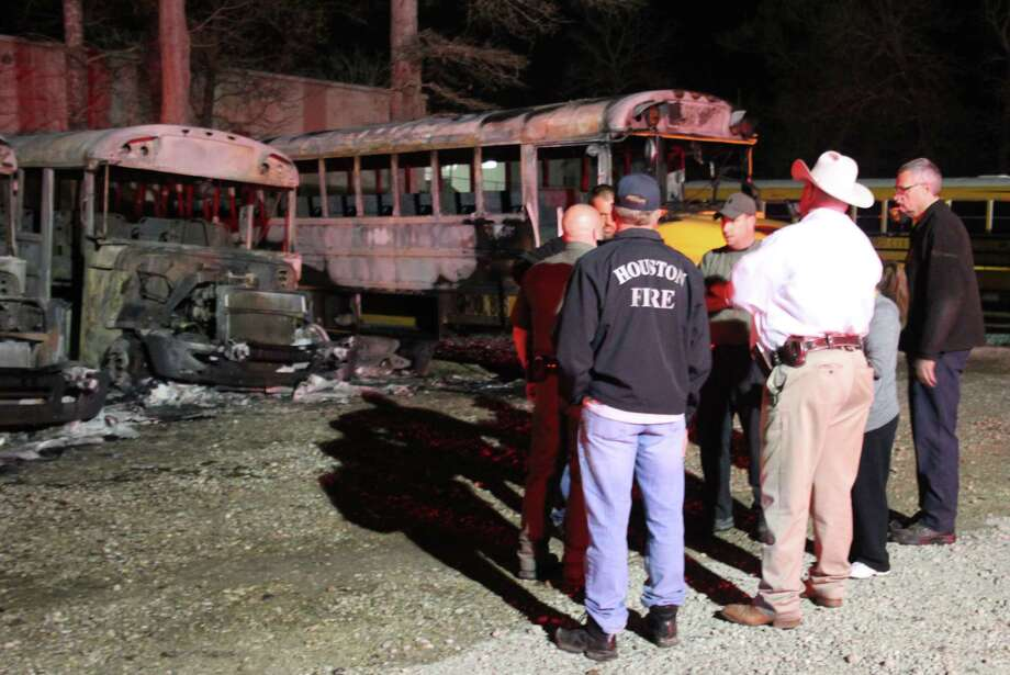 Coldspring-Oakhurst CISD school staff and board members along with San Jacinto County firefighters and law enforcement assess the situation at the school district's bus barn on March 14 where a fire damaged five buses. Photo: Jacob McAdams