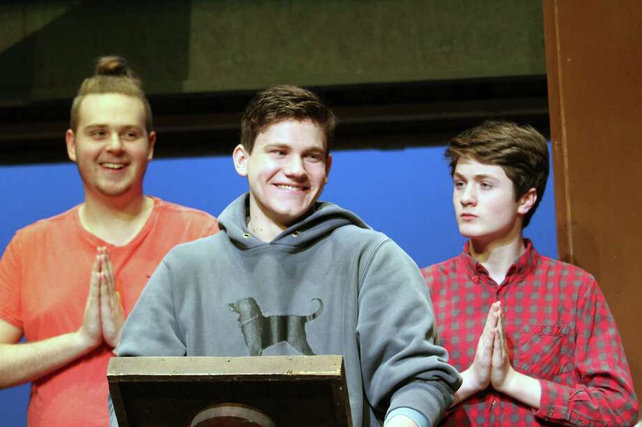 "Darien High School senior Jack Savage, center, will play the dance-averse Rev. Shaw Moore in Darien's production of ""Footloose,"" which will be performed March 22, 23 and 24 in Darien, Conn. Photo: Justin Papp / Hearst Connecticut Media / Darien News"