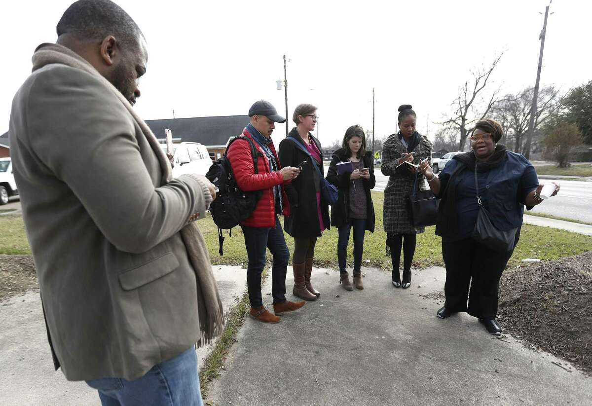 Tanya Debose, executive director of the Independence Heights Redevelopment Council talks with others concerned about what the widening of Interstate 45 will do to the community north of Loop 610 on Jan. 5.