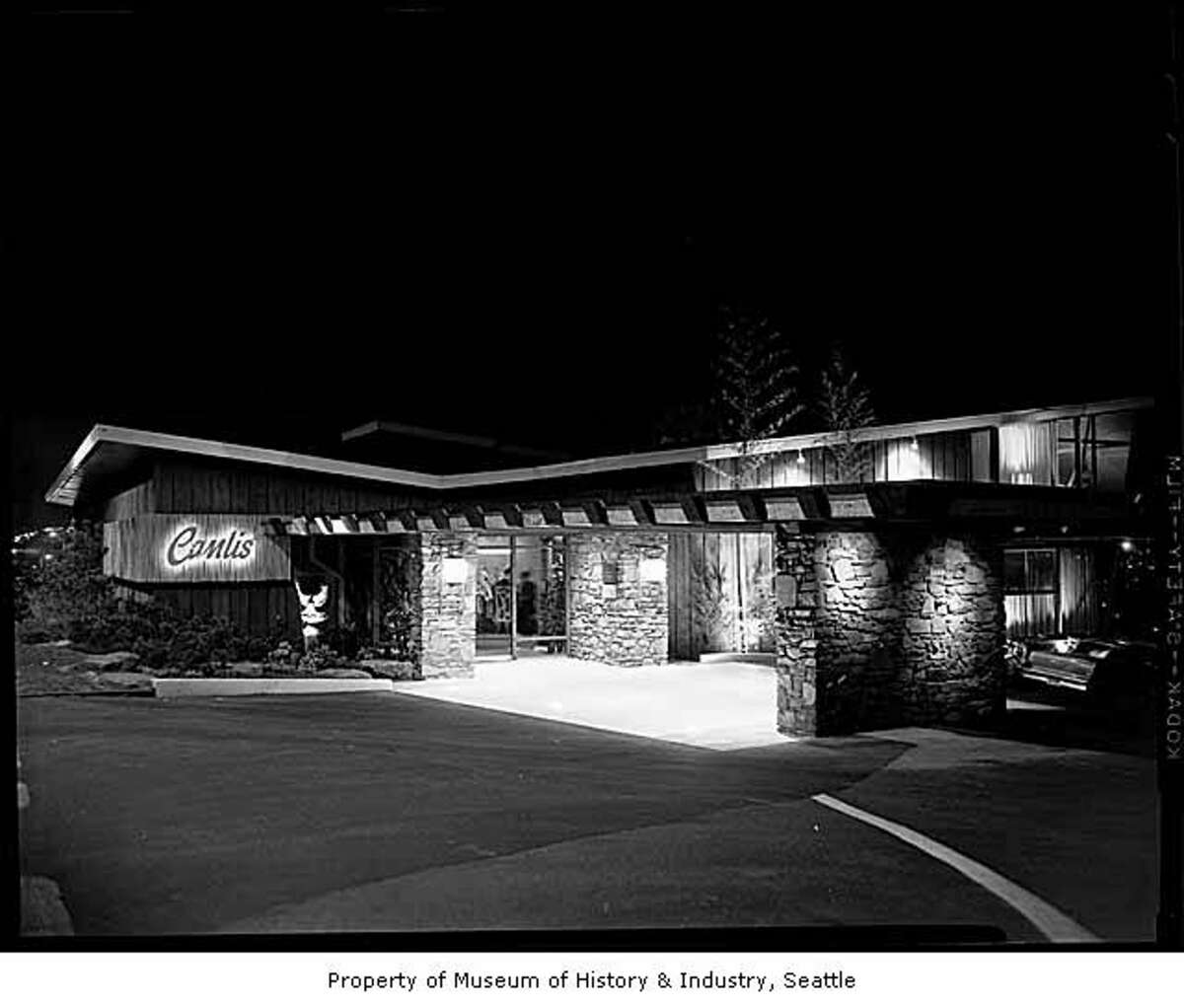Canlis restaurant at night, Seattle, 1958. Canlis has maintained a reputation as one of Seattle's finest dining establishments. Located at the south end of the Aurora Bridge, the building was designed by Roland Terry and has a wonderful view to the north and east.