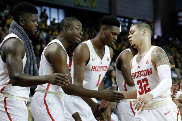 Houston guard Rob Gray (32) gets congrats from forward Nura Zanna (13), forward Gabe Grant (20) and center Chris Harris Jr. (1) on the bench as he comes in for a break during the second half of their game against Wichita State at H&PE Arena at Texas State University Saturday, Jan. 20, 2018, in Houston, TX. (Michael Wyke / For the  Chronicle)