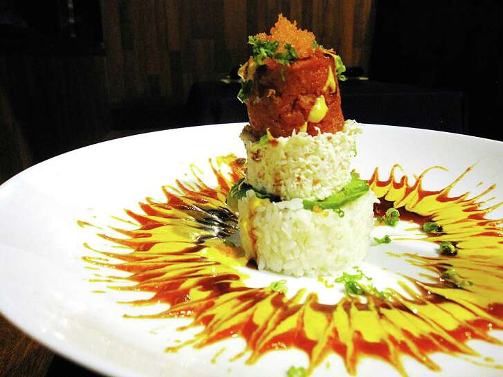 Ahi Tower with rice, crab salad and spicy tuna from Yummi Japanese Restaurant.