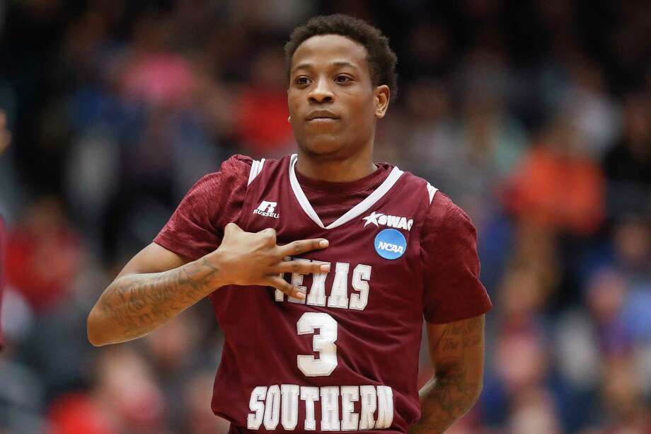 Texas Southern's Demontrae Jefferson reacts after scoring a 3-point shot during the second half against North Carolina Central in a First Four game of the NCAA men's college basketball tournament Wednesday, March 14, 2018, in Dayton, Ohio. Texas Southern won 64-46. (AP Photo/John Minchillo) Photo: John Minchillo, Associated Press / AP