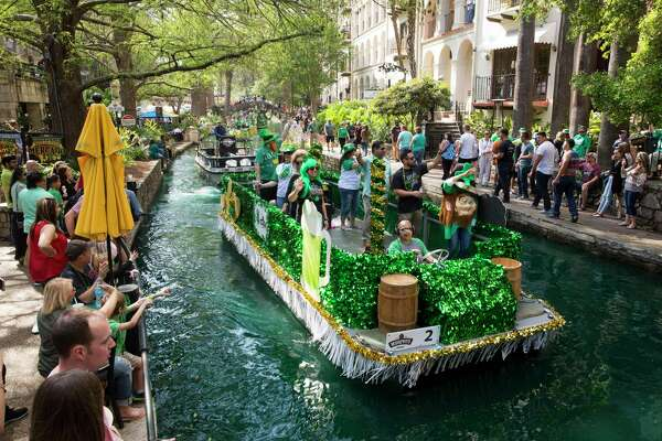 A parade floats down the river during the Murphy's St. Patrick's Day River Parade in San Antonio, Texas on March 18, 2017. Ray Whitehouse / for the San Antonio Express-News