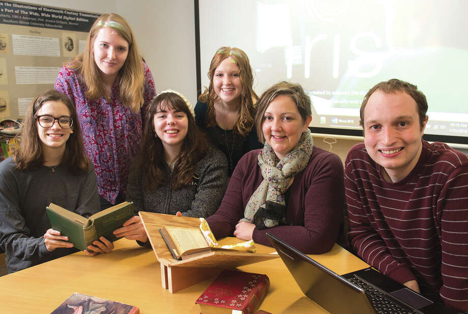 Dr. Jessica DeSpain (second from right) sits in the SIUE IRIS Center with student researchers and colleagues (L-R) Michaela Justus, Katie Knowles, Sarah Burt, Allyson Taylor and Ben Ostermeier. Photo: For The Intelligencer
