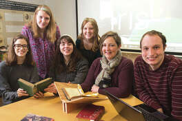 Dr. Jessica DeSpain (second from right) sits in the SIUE IRIS Center with student researchers and colleagues (L-R) Michaela Justus, Katie Knowles, Sarah Burt, Allyson Taylor and Ben Ostermeier.