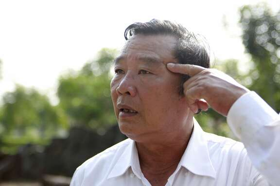 In this Wednesday, March 14, 2018, photo, massacre survivor Pham Thanh Cong points at a scar caused by grenade fragments during the My Lai massacre in Son My, Vietnam. On March 16, 1968, U.S soldiers of Charlie Company, sent on what they were told was a mission to confront a crack outfit of their Vietcong enemies, met no resistance, but over the course of three to four hours killed 504 unarmed civilians, mostly women, children and the elderly, in My Lai and a neighboring community. Cong's mother and his four siblings were killed; he survived, protected underneath their torn bodies. (AP Photo/Hau Dinh)