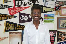 Henry Sneed has been cutting hair in the Woodlands for 40 years. He opened his own shop, which is decorated in sports memorabilia and pendants from schools his customers have attended, in 1992.