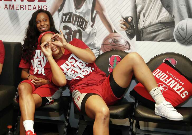 Stanford guard Kiana Williams, left, and guard DiJonai Carrington, right, joke around as they watch the television broadcast of their selection in the NCAA women's college basketball tournament Monday, Mar. 12, 2018 in Stanford, Calif. Stanford will host the first two rounds in the NCAA Tournament and will open as a No. 4 seed against 13-seed Gonzaga.