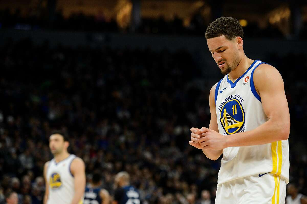 Klay Thompson #11 of the Golden State Warriors looks on during the game against the Minnesota Timberwolves on March 11, 2018 at the Target Center in Minneapolis, Minnesota.