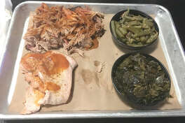 A platter from 17th Street Barbecue at 2700 17th St. in Marion, featuring pork shoulder, smoked turkey, brisket green beans and collard greens.