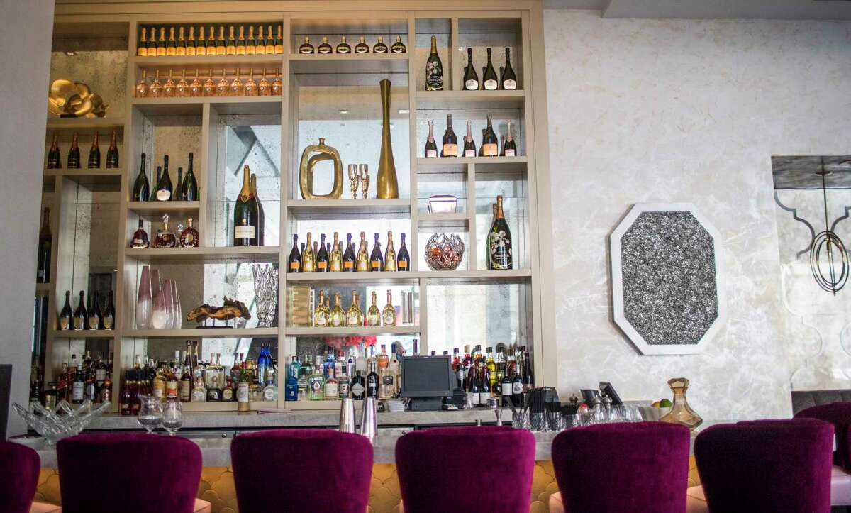 The Bloom & Bee bar and restaurant has fresh decor in shades of pink and beautiful Venetian plaster wall treatments.