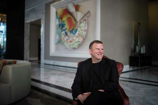 Landry's Inc. CEO Tilman Fertitta sits in the lobby of his new 250-room hotel The Oak Hotel. Wednesday, March 14, 2018, in Houston.