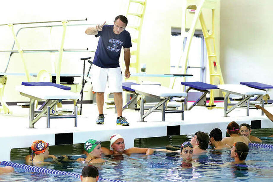 Edwardsville YMCA Breakers coach Bob Rettle gives swimmers instructions during a practice at the Chuck Fruit Aquatic Center. The Breakers will play host to the 25-team YMCA Heartland Area Championships Friday, Saturday and Sunday. Photo: Telegraph File Photo