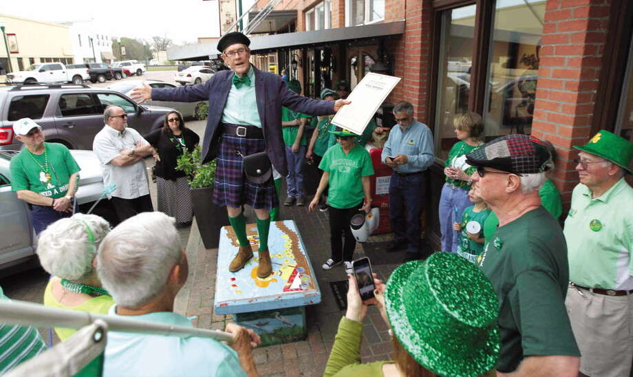 Michael McDougal reads the Proclamation of the Irish Republic before the annual St. Patrick's Day walking parade in downtown Conroe. This year's parade is set for 4 p.m. Saturday in front of The Red Brick Tavern in downtown Conroe. Photo: Jason Fochtman / Internal