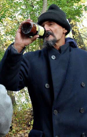"Samuel ""Poppy"" Baez, right, drinks a beer while hanging out in the woods with his friend Andrew on Wednesday, Oct. 14, 2009, at the Corning Preserve in Albany, N.Y. (Cindy Schultz / Times Union) Photo: CINDY SCHULTZ"
