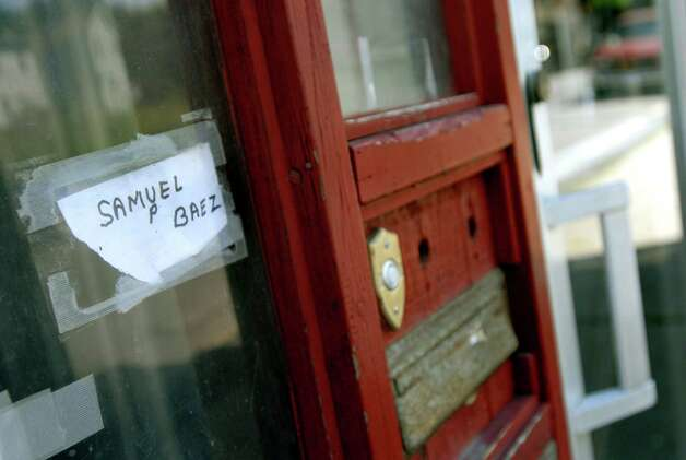 "Samuel ""Poppy"" Baez has his name taped on a window outside his home on Tuesday, Aug. 11, 2009, on Delaware Street in Albany, N.Y. (Cindy Schultz / Times Union) Photo: CINDY SCHULTZ"