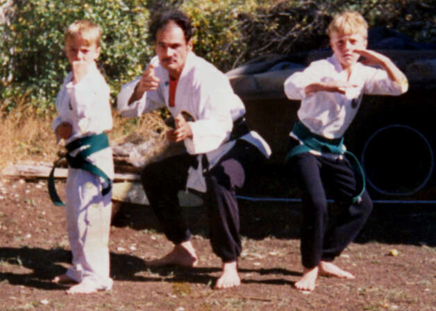 "Samuel ""Poppy"" Baez, center, strikes a karate pose with his stepsons. (Handout for Times Union. Courtesy of Jane Baez.)"