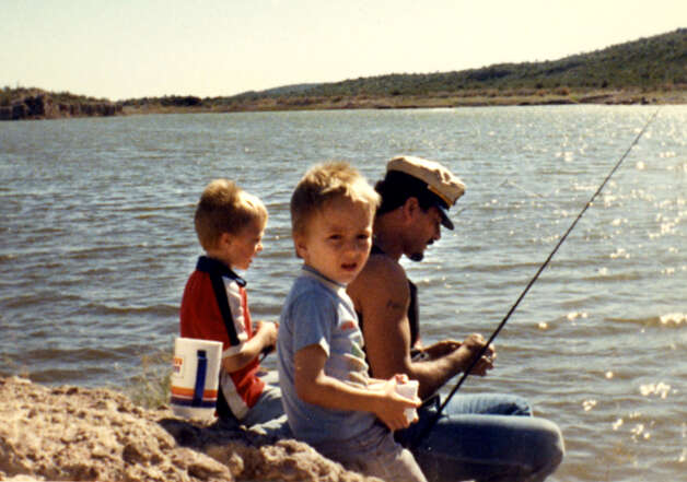 "Samuel ""Poppy"" Baez, right, fishing with his stepsons. (Handout for Times Union. Courtesy of Jane Baez.)"