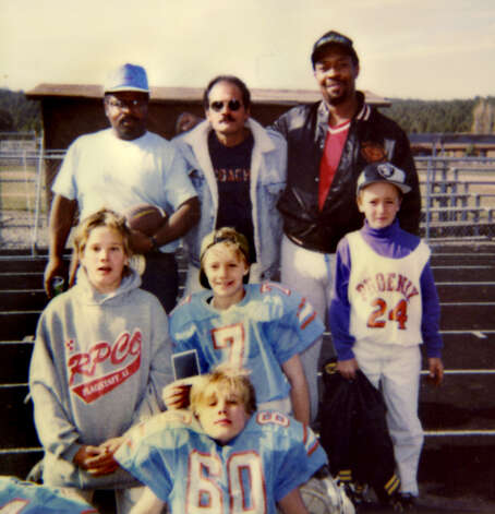 "Football coach Samuel ""Poppy"" Baez, top center, with his stepsons Adam (80), front, and Andrew (24), middle right. (Handout for Times Union. Courtesy of Jane Baez.)"