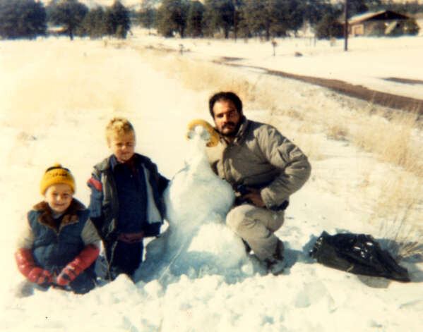 "Samuel ""Poppy"" Baez, right, with his stepsons building a snowman. (Handout for Times Union. Courtesy of Jane Baez.)"