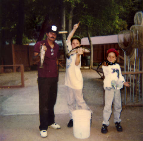 "Samuel ""Poppy"" Baez, left, with his stepsons Adam, center, and Andrew, right, after fishing. (Handout for Times Union. Courtesy of Jane Baez.)"