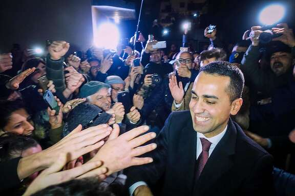 Italian 5-Star Movement's leader and candidate for the post of Italian Prime Minister Luigi Di Maio, celebrates their electoral victory with his supporters in Volla, near Naples, Italy, Tuesday, March 6, 2018. The 5-Stars Movement's better-than-expected 32 percent showing was boosted by its dominance of the south, where Forza Italia had long held sway. (Cesare Abbate/ANSA via AP)